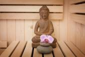 Ayurveda symbols for relaxation and inner beauty,buddha statue in sauna — Photo