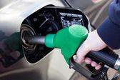 Man filling up car with fuel at petrol station — Fotografia Stock