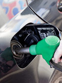 Man filling up car with fuel at petrol station — Stock Photo