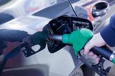 Man filling up car with fuel at petrol station — ストック写真
