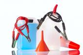 Windshield washer fluids and jump start cables — Stock Photo