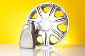 Alloy wheel and car accessories — Stock Photo