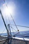 Catamaran sailboat. calm blue ocean and cloudless blue sky are in the background — Foto Stock