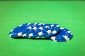 Stack of poker chips on a green table — Stock Photo