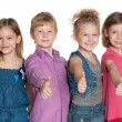 Four happy children hold his thumbs up — Stock Photo #53431959