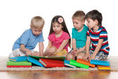 Little children with books on the floor — Stock Photo