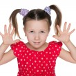 Smiling little girl is showing her hands — Stock Photo #54091129