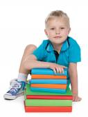 Clever little boy with books — Stock Photo