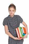 Clever young girl holds books — Stockfoto