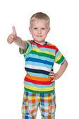Schattige kleine jongen houdt zijn duim omhoog — Stockfoto