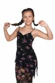Pretty young girl with pigtails — Stock Photo