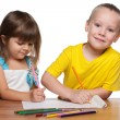 Children draws at the desk — Stock Photo #59938611