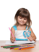 Preschool girl at the desk — Stock Photo