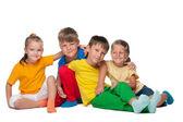 Four cheerful kids — Zdjęcie stockowe