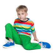 Cute little boy in a striped shirt — Stock Photo