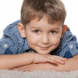 Thoughtful boy on the white carpet — Stock Photo #65675601