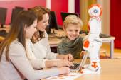 Child playing and learning with robot — Stock Photo