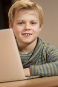 Young pupil learning his homework — Stock Photo