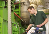 Male technician repairing agriculture machinery — Stock Photo