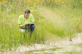 Enviromental scientist researching the environment and natural d — Stock Photo