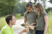 Pretty young girls having outdoor science lesson  exploring natu — Stock Photo