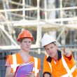 Architect Showing Something To Colleague At Construction Site — Stock Photo #71767609