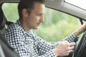 Man Using Mobile Phone While Driving Car — Stock Photo