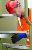 Confident Male Worker Repairing Storage Tank Steps — Stock Photo