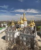Kind to the Uspensky cathedral of the Kiev Pechersk Lavra in the foreground, the river Dnepr and Kiev on horizon. — Stock Photo