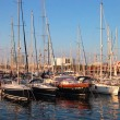 Yachts at the Port of Barcelona Harbor, Spain at the sunset — Stock Photo #53875277
