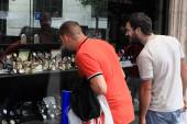 GENEVA, SWITZERLAND - JULY 15. 2014. Two young men looking in th — Stock Photo