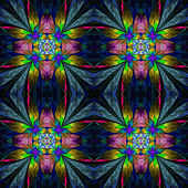 Symmetrical multicolored flower pattern in stained-glass window — Stock Photo