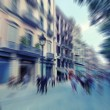 Abstract background. Pedestrians walking - rush hour in Barcelona, Spain.  Radial zoom blur effect defocusing filter applied, with vintage instagram look. — Stock Photo #70702751