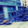 Abstract background. Traffic blur motion in modern city  - rush hour in Barcelona, Spain.  Radial zoom blur effect defocusing filter applied, with vintage instagram look. — Stock Photo #70702757