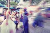 Abstract background. Blurred crowd, bride and groom on the Boul — Stock Photo