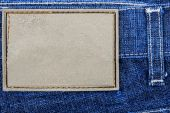 Label sewed on a blue jeans — Stock Photo