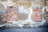 Old wall with bricked up windows — Stock Photo