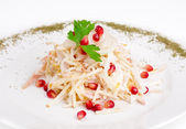 Salad with squid, onion, apple and pomegranate — Stock Photo