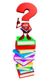 Question Mark character with books pile — Stock Photo