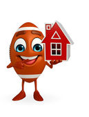 Rubgy ball character with home — Stock Photo