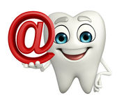 Teeth character with at the rate sign — Stock Photo