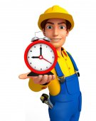 Young Mechanic with table clock — Stok fotoğraf