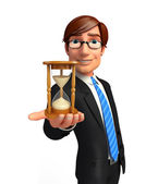Young Business Man with sand clock — Stock Photo