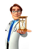 Young Doctor with sand clock — Stock Photo