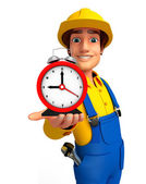 Young Mechanic with table clock — Stock Photo