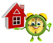 Table clock character with home — Stock Photo