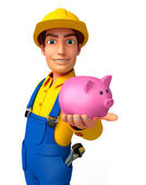 Young Mechanic with piggy bank — Stok fotoğraf