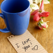 Coffee mug with lipstick mark and a note — Stock Photo #61415231