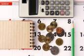 Notebook, calculator, calendar, pencil and coins — Stock Photo