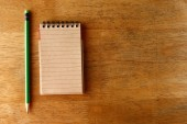 Pencil and a notebook on a table — Stock Photo